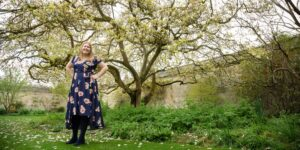 Hannah stood in front of a magnolia tree in blossom